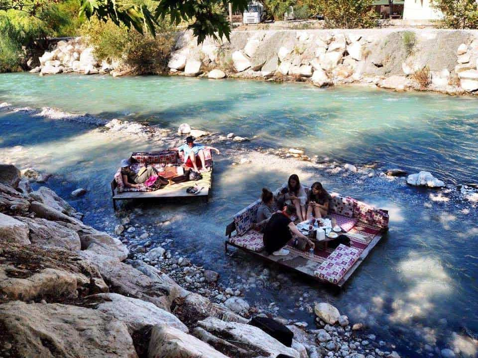 Eating in the river at The gorge at Saklikent Turkey