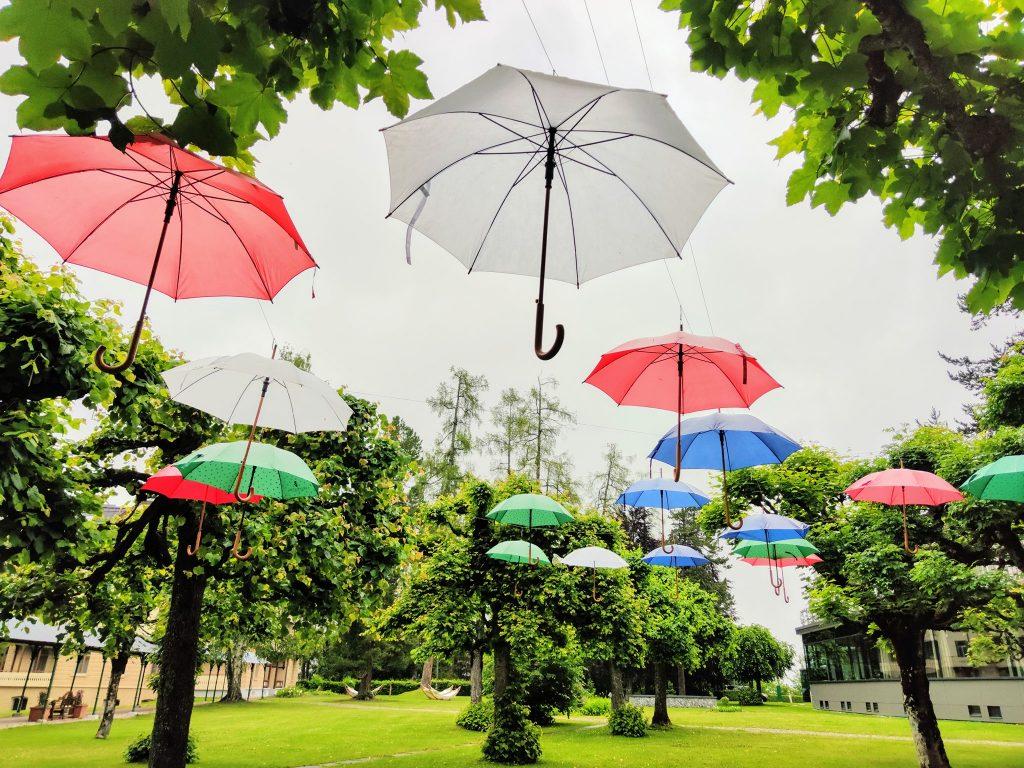 Umbrellas in garden Waldhaus Flims Wellness Resort
