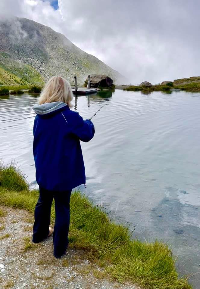 Fishing at Kreuzboden lake Saas Fee